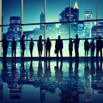 MOOC Summaries - Designing Cities - Visionary Cities - Silhouettes of business people standing in an office building.